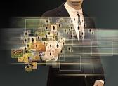 Businessman and modern technology — Stock Photo