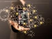 右の人を選択する携帯電話を保持している実業家 — ストック写真