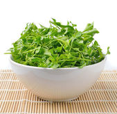 Watercress in bowl on bamboo   — Stock Photo
