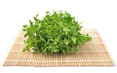 Watercress  on bamboo   — Stock Photo
