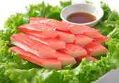 Decorate crab stick in white plate — 图库照片