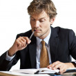 Businessman trying to figure out the work — Stock Photo