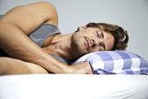 Young man sleeping — Stock Photo