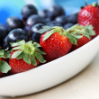 Fruit salad with strawberry and grape — Stock Photo