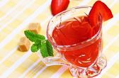 Fresh red tea and tasty fruit with mint — Stock Photo