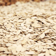 Pumpkin seeds for sale in supermarket — Stock Photo #28853835