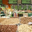 Boxes of hazelnuts, walnuts and chestnuts in supermarkets — Stock Photo #28853861