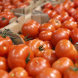 Ripe tomatoes for sale in big supermarket — Stock Photo #28853891