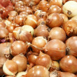 Onions for sale in supermarket — Stock Photo #28853921
