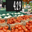 Tomatoes for sale in grocery — Stock Photo