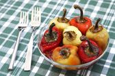 Colorful bell peppers baked with oil in a glass bowl — Stock Photo