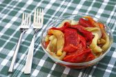 Colorful salad of roasted peppers — Stock Photo