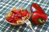Colorful salad of roasted peppers with one red capsicum — Stock Photo
