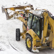 Stock Photo: Excavator cleans snow blocked parking