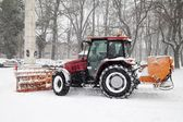 The tractor removal snow in park — Stock Photo