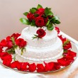 Wedding cake with red roses — Stock Photo #28870111