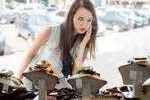 Beautiful girl choosing jewelry in shop — Stock Photo