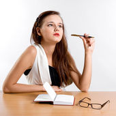 Thinking businesswoman sitting at her desk — Stock Photo
