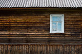 Wooden wall with window — ストック写真