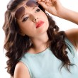 Attractive young brunette woman in sunglasses — Stock Photo