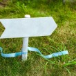 Wooden sign on a grass — Stock Photo