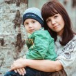 Mother with son in autumn park — Stock Photo