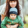 Mother with son in autumn park, happy family — Stock Photo