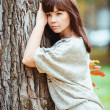 Photo of beautiful pretty brunette woman in park — Stock Photo