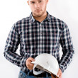Portrait of a man wearing checkered shirt and helmet — Stock Photo