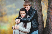 Husband tender hugs his pregnant wife — Stock Photo