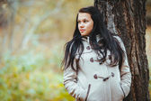 Photo of beautiful pretty brunette girl in park — Stock Photo