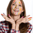Happy girl with painted face and hands in colorful paints — Stock Photo #34352379