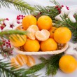 Christmas decoration with mandarins and fir tree — Stock Photo