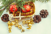 Bright christmas composition with delicious gold candy — Stock Photo