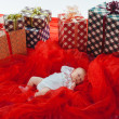 Colorful gift boxes with beautiful baby — Stock Photo