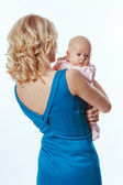Young mother with a charming baby girl — Stock Photo