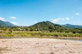 Small river, hills and sand — Stock Photo