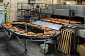 Breads on production line at bakery — Stock Photo