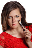 Portrait of beautiful woman applying cosmetic. Make-up — Stock Photo