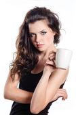 Brunette woman having cup of tea — Stock Photo