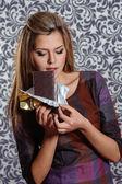 Beautiful young woman bites off chocolate — Stock Photo