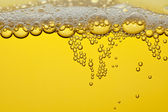 Bubbles and foam in a beer — Stock Photo