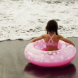 Girl with a pink rubber ring — Stock Photo #28359557