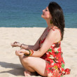 Woman in red dress meditating — Stock Photo