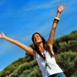 Happy woman standing with outstretched arms — Foto Stock