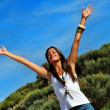 Stockfoto: Happy womstanding with outstretched arms