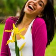 Portrait young woman laughing in the park — Stock Photo