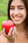 Portrait of smiling woman with an apple — Stock Photo
