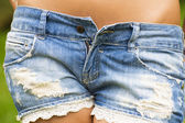 Sexy denim low-cut shorts closeup — Stock Photo