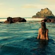 Back of a young woman in the sea water — Stock Photo #28449447